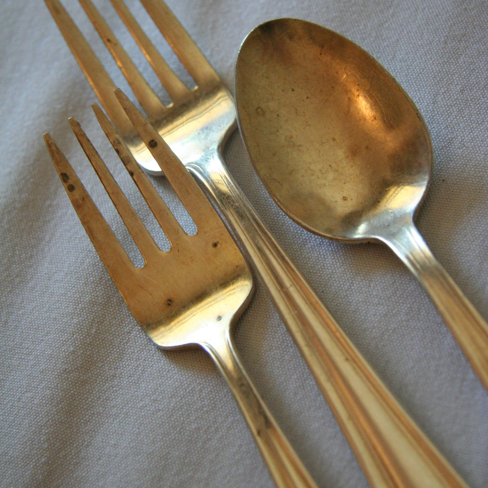 gold spoon and forks